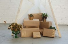 Kraft wrapping with gold paint patterns.