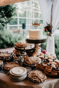 9 Wedding Dessert Table Ideas to Sweeten Your Reception Decor 9 Wedding Dessert Table Ideas to Sweeten Your Reception Decor Display your wedding desserts on wood planks to add a rustic touch to your reception decor Rustic Wedding Desserts, Dessert Bar Wedding, Wedding Cake Stands, Wedding Cakes, Wedding Pie Table, Donut Wedding Cake, Wedding Rustic, Chic Wedding, Buffet Dessert