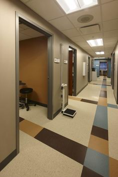 The exam room corridor features a colorful floor pattern to help identify the room entries. Photo: Brian Moberly/Moberly Photography.