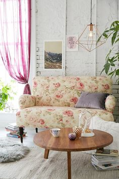 Tessa Loveseat We love this loveseat in an allover floral wallpaper print. The Tessa loveseat sofa features feminine curved lines with cushy armrests. Finished with solid turned wood legs.