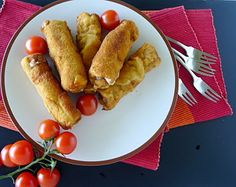 Flamenquines, fried pork rolls with ham and cheese.