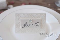 DIY wedding place cards with embossed detail and crystal pearl embellishment