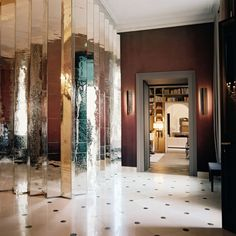 Elegant entryway with a pleated mirror wall