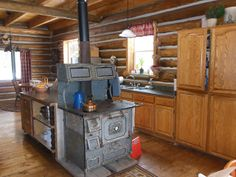 log cabin kitchen with wood cook stove