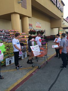 "Swarm in LA talking to managers at Home Depot about why they need to ""show bees some love"" and stop selling bee-killing pesticides. Photo taken by Planet Rehab"