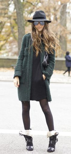 Arielle Nachami is wearing a green coat from Zara, black dress from Blessed Are The Meek, shoes from Isabel Marant, bag from Chanel and the hat is from TopShop