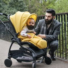 Chris John Millington poses with a bearded baby - full thick dark beard beards mustache well dressed dapper mens style fall winter clothes handsome babies dad father