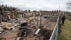 """""""Fort McMurray is still alive,"""" Fire Chief Darby Allen told reporters during a tour of the wildfire destruction.  His message to displaced residents: """"We're ready for the future and when we get you back, we can build the future together."""""""