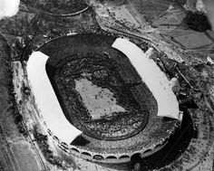 Overflowing: A bird's eye view of Wembley Stadium, London, during Bolton's 1923 FA Cup victory over West Ham. An estimated 200,000 people crammed in, leading to an inevitable pitch invasion.
