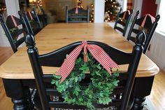 Christmas chair wreaths.. I've made these, they're simple!!