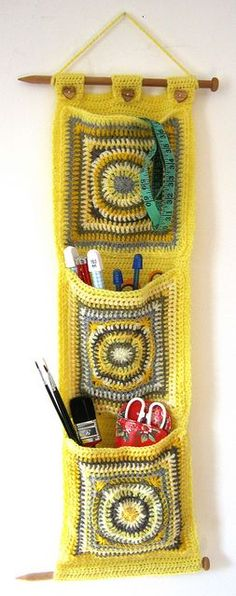Crochet Wall Pockets by tree_bridge.... What a fantastic, cute idea! Even the wooden knitting needles as the wooden hangers! Love! So cute!