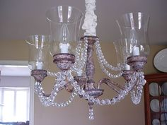 """Amazing transformation!!!   Go to the site to see """"before"""" photo of cheap builder-grade brass light.  Instructions on how to give rusted look, add beading and chain cover, too."""