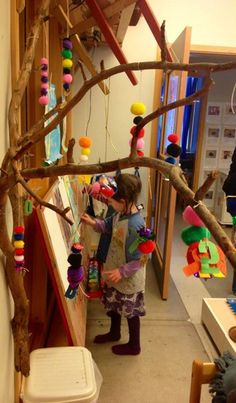 "These threaded pom-poms look pretty hanging from the branch - from Ekuddens förskola, Bubblan ("",)"