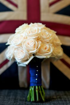 Simple White roses bridal bouquet.  Without the england flag in the back...