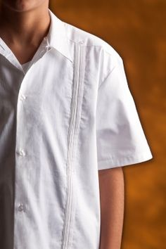 """http://www.theguayaberashirtstore.com/kidsteens-guayaberas.html  For kids ages four through twelve.  Our Kids J. Edwards """"Classic"""" embroidery shirt is made from 100% """"pinpoint cotton oxford"""".  This design is patterned after the traditional Guayabera as worn in Mexico and Latin America.  It features a beautiful embroidery pattern on the front of the shirt, no pockets and a vented hem."""