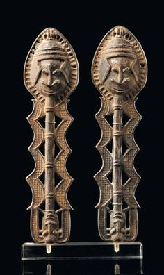 Africa | Pair of Edan staffs from the Yoruba people of Nigeria | Brass, with dark patina | Edan staffs were important ritual objects in Ogboni society. They were worn around the neck as a symbol for membership. They protected their owners against diseases and played an important role during funeral celebrations.