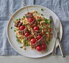 Spiced lamb kebabs with pea & herb couscous. These peppery paprika lamb skewers are barbecue friendly. Serve with a vegetable couscous flavoured with mint and coriander