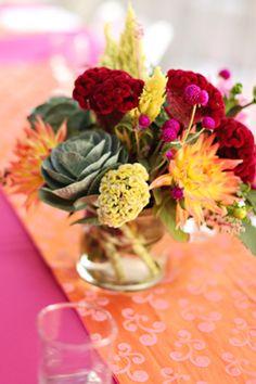 bright pink, red, orange and yellow flower wedding centerpiece with dahlias, celosia and kale | photo: www.eyespy-weddings.com