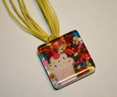 resin necklace with a cupcake and candy sprinkles