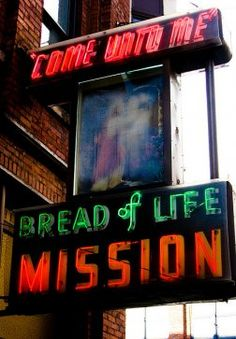 """Not all neon shouts drinks, food and coffee. The longtime Bread of Life mission sign in Pioneer Square beckons people to """"come unto me."""""""
