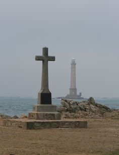 The cross is on Normandy beach with the lighthouse in the distance. Original photo taken in France by Christy Dowdle Normandy Beach, Normandy France, D Day Landings, Beacon Of Light, Lake Geneva, Sardinia, France Travel, Towers, Crosses