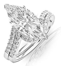 I love this one 1.45 Carat GIA Certified Marquise Cut / Shape 14K White Gold Curving Pave & Prong-set Round Diamond Engagement Ring