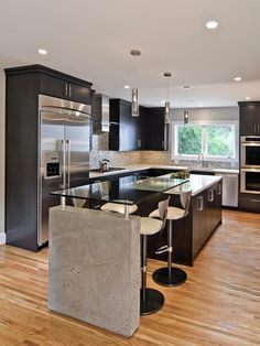 Contemporary Kitchen With Bar and Red Barstools : Designers' Portfolio : HGTV - Home & Garden Television