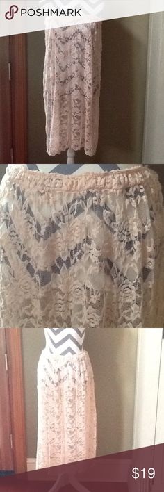 Free People Lace Slip/Skirt Worn a few times as a swim cover up as pictured in the cover photo. Peach lace skirt. No lining. Awesome as an overlayer, dress extender or coverup. Free People Skirts