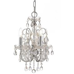 This Crystorama Imperial collection chandelier adds beauty and elegance to any room. The four-light fixture features a polished chrome finish and hand-polished crystal accents.