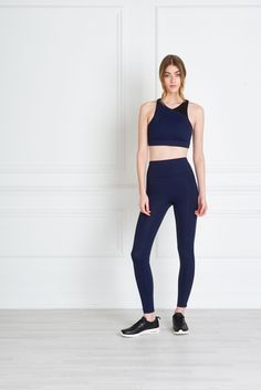 Bridget Sports Bra - Early morning runs and high intensity training sessions have never looked so good. The medium to firm fitting Bridget Sports Bra may have technical ferocity, but it manages to wear with the elegance of silk. Made with non-toxic material and indestructible bonded seams, it is finished with a high neckline and reverse side logo. Pair with the Nadya long or crop leggings for an immaculate sports-luxe look.