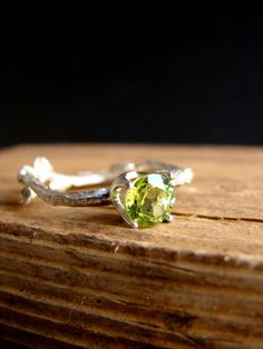 Peridot Gemstone Branch Jewelry Twig Ring Engagement Ring Sterling Silver Botanical Ring August Birthdays Leo Birthstone  A gorgeous peridot measuring 6mm held securely by a 4 prong setting on a sterling silver twig ring.  This ring was made using the lost wax technique, one of the most ancient ways to create jewelry! http://en.wikipedia.org/wiki/Lost-wax_casting   All my items are custom made so please allow at least two weeks before shipment and bear in mind that the rin...