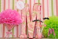 cute for center pieces...i like the pink puff thing!