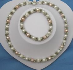 XaXe.com - Fashionable White & Pink Pearl Necklace And Bracelet