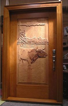 Come home to THIS beautiful hand carved door!
