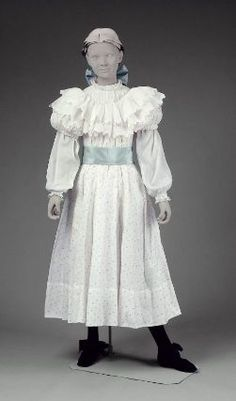 Girl's dress in three part (blouse)        American, 1899         USA  Dimensions      Legacy dimension: CF: 36 in.  Medium or Technique      Cotton and silk  Classification      Costumes