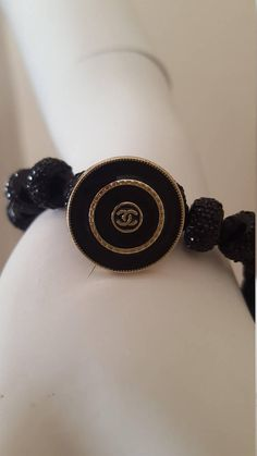 Check out this item in my Etsy shop https://www.etsy.com/listing/514755282/chanel-button-rope-and-bead-bracelet