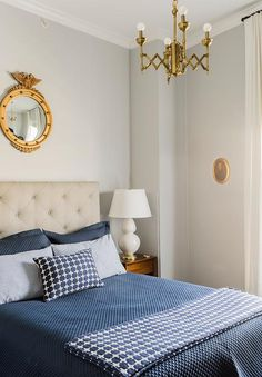 Gray and gold bedroom with blue accents