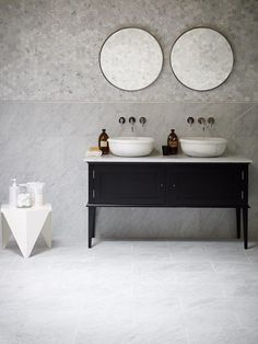 Chelsea Vanity painted Farrow & Ball pitch black with Calacatta basins with Carrara tiles and hexagons.