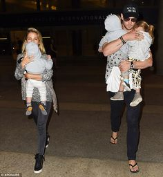 Here they come: Chris and Elsa were seen arriving at LAX International Airport on Sunday ...