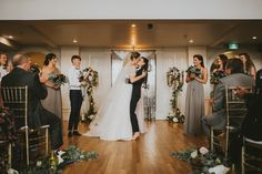 Grand kiss from this vintage inspired wedding at Vancouver's The Permanent | Image by Sara Rogers Photography