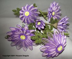 Beautiful purple quilled flowers, by Roxann Dragula!