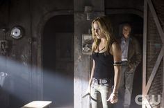 """Arrow -- """"Keep Your Enemies Closer"""" -- Image AR206b_0005b -- Pictured (L-R): Caity Lotz as Sara Lance and Dylan Neal as Dr. Anthony Ivo -- Photo: Ed Araquel/The CW -- © 2013 The CW Network, LLC. All Rights Reserved"""