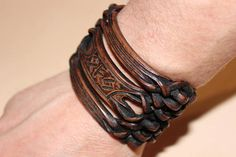 Wide biker bracelet. Exclusive leather bracelet with a runic