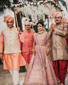 Beautiful indian wedding with a bride in an onion pink sabyasachi lehenga with tasseled net dupatta with sequin and thread work embroidery Goa Wedding, Desi Wedding Decor, Indian Wedding Decorations, Wedding Bride, Wedding Stage, Stage Decorations, Wedding Garlands, Wedding Mehndi, Wedding Mandap
