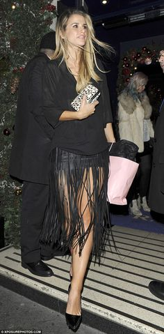 Fringe benefits: Vogue Williams was also seen at the party, showing off her amazing legs in a tiny black fringed mini skirt