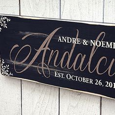 Black last name in script font, painted on a beautiful rustic wood finish