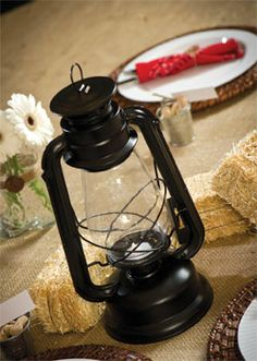 This western lantern will be a cute centerpiece for a western prom.