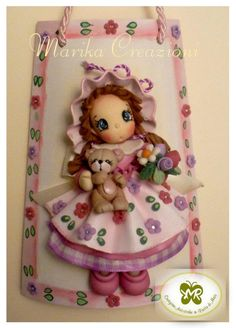 cute little girl wallhanging (partly in clay) (photo)
