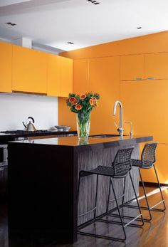 Vibrant Three Color Palette - Tangerine cabinets are unexpected but work well with dark grey and white