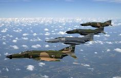 The real angry birds: A formation of F-4 Phantom II fighters in a variety of camouflage patterns.